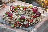 Thanksgiving wreath with wheat, apples and ornaments