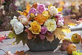 Autumn bouquet of pink (rose) with leaves sleeve