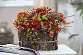 Autumn arrangement in bark-clad bowl