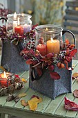 Autumn felt bags with candles in jars, wreaths from Malus