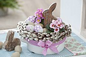 Easter nest in enamel pot with wreath made of salix (palm kitten)