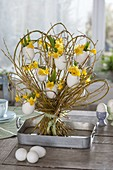 Willow with eggshells as vases standing bouquet