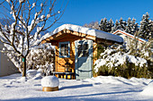 Garden with garden house in winter, Bavaria, Germany