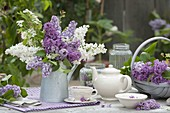 Fragrance syringa bouquet in zinc can, tea with lilac flowers