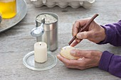 Egg coloring with wax reservation technique