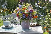 Colorful cottage garden bouquet from Centaurea (cornflower)