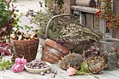 Basket with dried summer flowers and herbs for the seed harvest