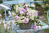 Fragrant arrangement in the basket, pink (rose), flowers of elderberry