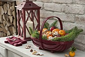 Red Santa Claus basket filled with oranges, mandarins, apples