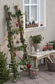 Christmas decorated wooden ladder with hedera, Led fairy lights