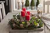 Rural Christmas wreath on wooden tray