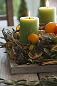 Mediterranean Advent wreath with olive branches, black dates, mandarins