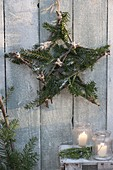 Star made of apple branches and fir green as a Christmas decoration