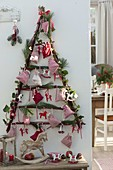 Stylized Christmas tree from dogwood branches as Advent calendar