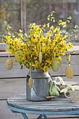 Easter bouquet with branches of Forsythia and Corylus