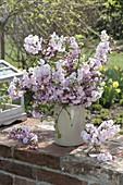 Lush bouquet with flowers of Prunus subhirtella and sargentii