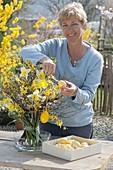 Woman decorates Easter bouquet