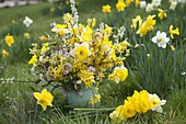 Yellow spring bouquet with daffodil and gold bells