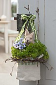 Cloth bag in wreath of betula branches with parsley