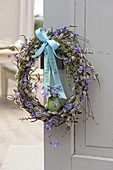 Elegant Easter wreath from branches of Salix, Betula