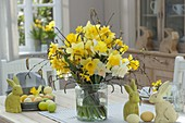 Easter bouquet with narcissus and betula in wide glass
