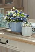 Spring bouquets in enamel milk pots myosotis
