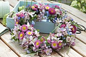 Wreath made of Bellis (daisies), Malus (ornamental apple), Myosotis