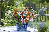 Colorful bouquet in salt glaze pot, Aquilegia (columbine), Myosotis