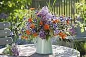 Blue-orange bouquet from Aquilegia, Syringa, Geum