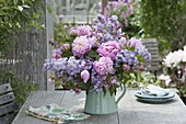 Fragrant bouquet of Paeonia and Syringa