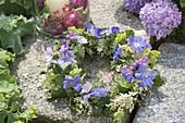 Wreath made of elderberry and geranium flowers