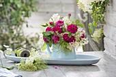Bouquet of roses 'Rose de Resht' and elderberry