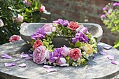 Wreath of different, fragrant flowers of Rosa, Alchemilla