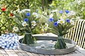 Standing bouquets on zinc tray
