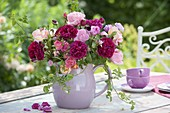 Pink (rose) bouquet in purple and pink in ceramic jug