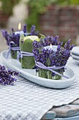 Lanterns in herb dress as a table decoration