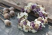 Wreath made of Papaver, Oregano and Hydrangea