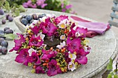 Muted wreath with flowers of Gladiolus, Anemone hupehensis