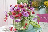 Late summer bouquet in wire basket Lathyrus odoratus, Zinnia