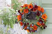 Edible flowers and herbs wreath on door handle