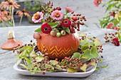 Decorative carved Hokkaido pumpkin vase (Cucurbita pepo)