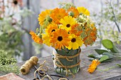Late summer bouquet of calendula and fennel flowers