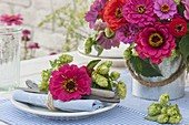 Late summer bouquet and napkin deco of zinnia and humulus