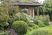 Late summer garden at the garden house with green roofs