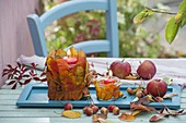 Autumn table decoration with leaves-lanterns and apples
