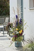 High arrangement of perennials and grasses on the doorstep