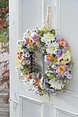 Door wreath from Dahlia, Aster, Rosa