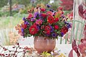 Autumn bouquet made of Zinnia, Aster, Rosa
