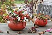 Pumpkin vases with branches of Rose, malus