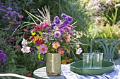 Colorful cottage's garden bouquet on the table at the aster bed